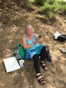 Karen painting at the beach
