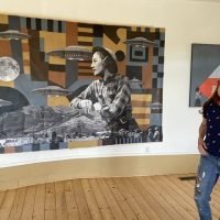 Karen Wippich and her large painting